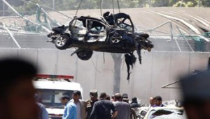 A damaged vehicle is removed from the scene of a suicide bomb attack in Kabul, Afghanistan, 31 May 2017. According to media reports quoting latest figures given by public health officials, at least 15 people were killed and over 300 were injured in suicide bomb attack near Kabul's diplomatic and government district on 31 May. The number of casualties is expected to rise, media added.  ANSA/HEDAYATULLAH AMID