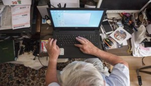 epa06911341 Attila Listvan (74) uses his computer in his home in Nyiregyhaza, Hungary, 23 July 2018 (issued 26 July 2018). Listvan is the organizer of many internet groups, and a keen documenter of the Szabolcs Folk Dance Group for decades. Older members of the family are also getting more and more comfortable in the digital world, with the use of two or more devices in their households to browse and keep in touch online. EPA/Attila Balazs HUNGARY OUT ATTENTION: This Image is part of a PHOTO SET