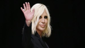 Italian designer Donatella Versace waves at the end of her Haute Couture Fall/Winter 2016-2017 fashion show for Atelier Versace in Paris, France, July 3, 2016. REUTERS/Gonzalo Fuentes