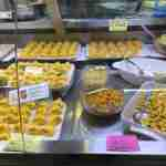 Flavors of Ferrara and Modena: Fresh tortellini and tortelloni for sale in Mercato Albinelli