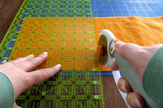 Cutting the fabric to make a taggie toy. http://www.itchinforsomestitchin.com