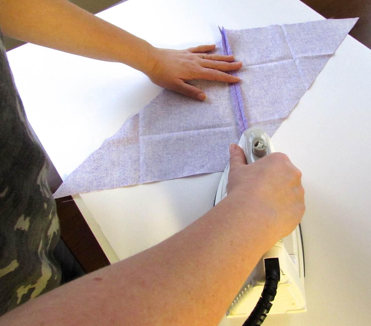 Ironing the fold to make bias tape by www.itchinforsomestitchin.com