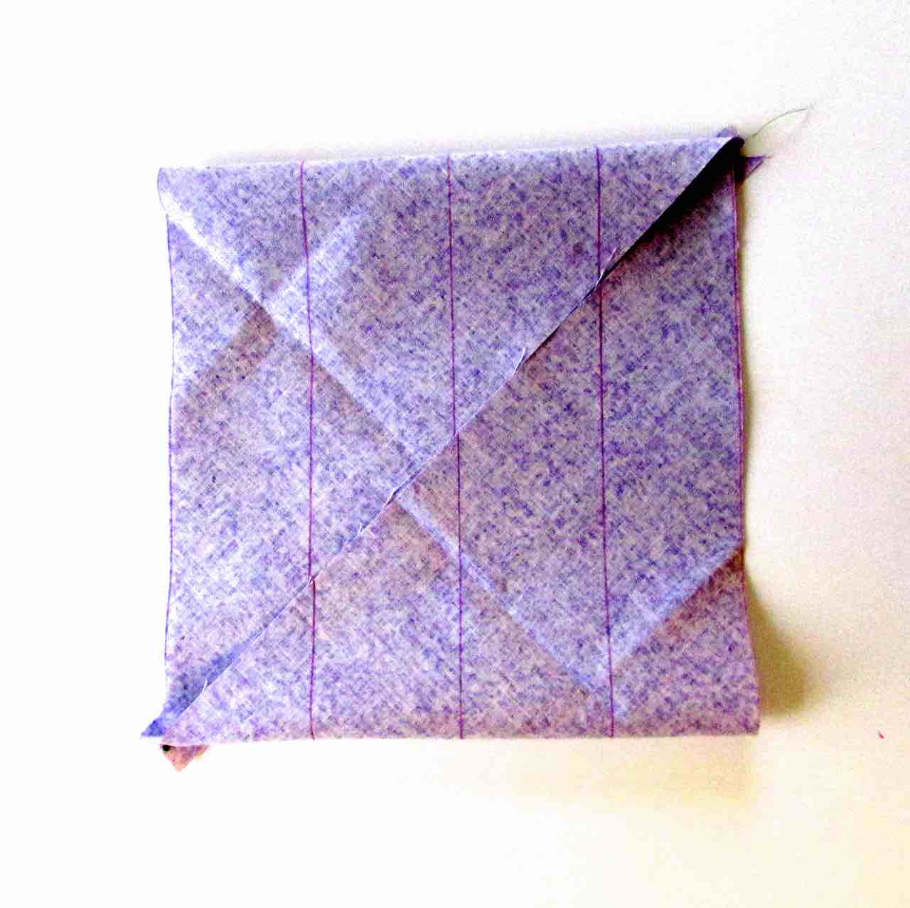 Parallelogram folded when making bias tape by www.itchinforsomestitchin.com