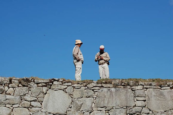 Staff watching over the ruins