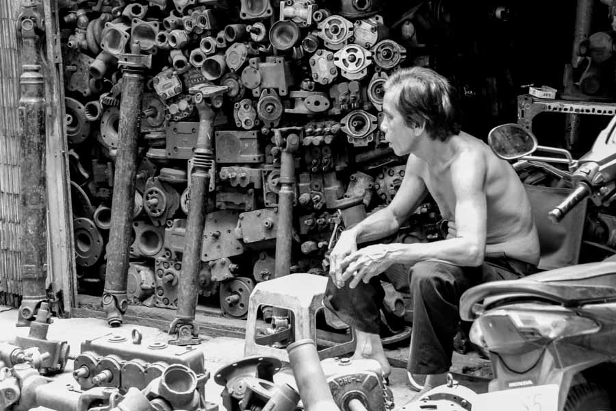 A man at a motor shop in Saigon, Vietnam