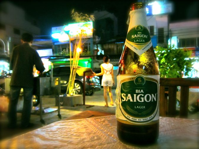 A bottle of Saigon Green Beer at a bar in Ho Chi Minh City