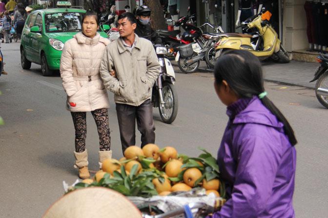 A couple walking in Hanoi, Vietnam