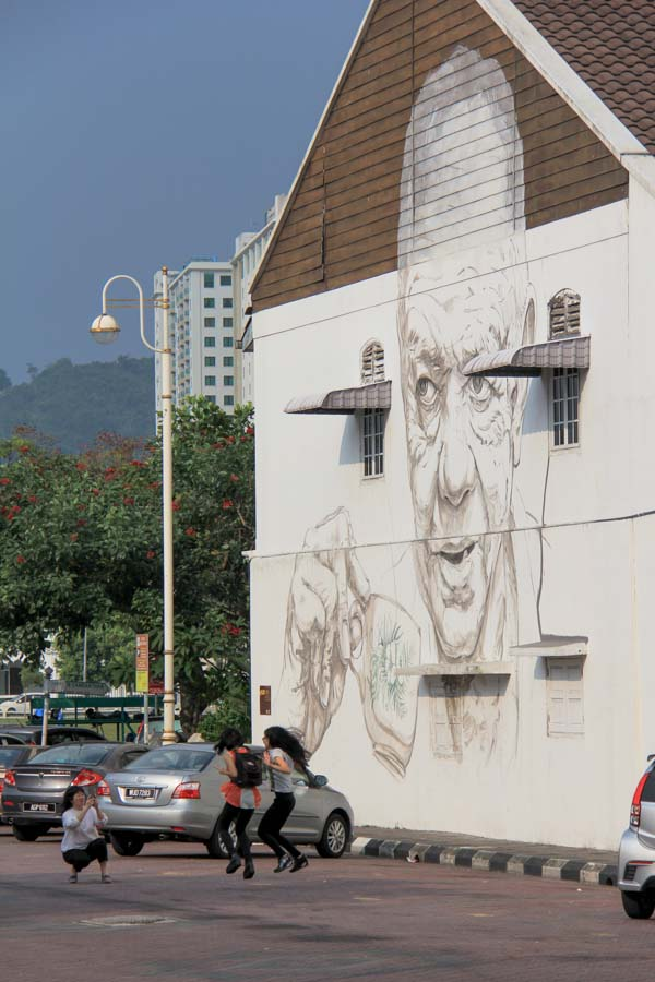 Man drinking coffee - street art in Ipoh.