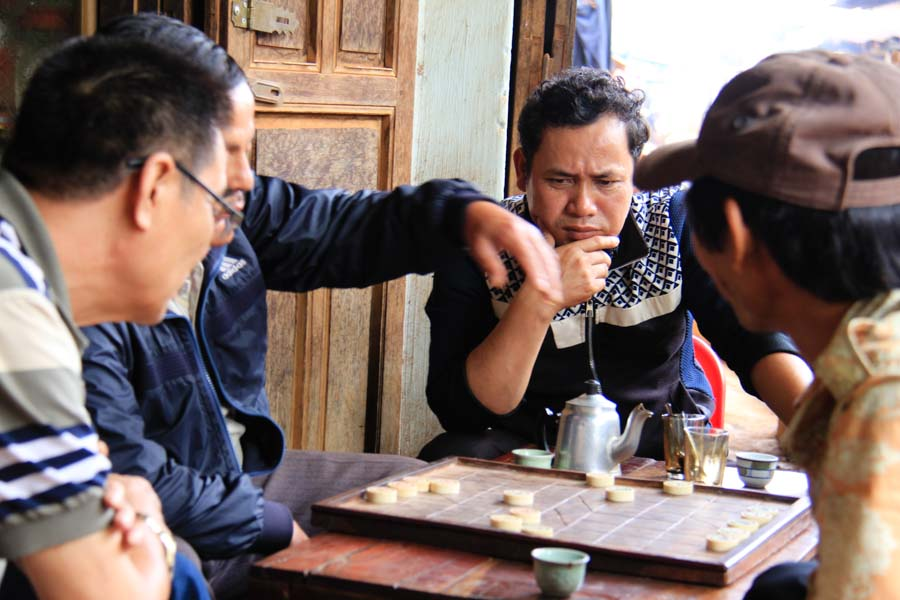 Men playing Chinese chess in Dak Lak, Vietnam
