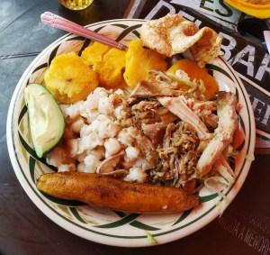 Plate of hornado - Ecaudor roast pig with sides