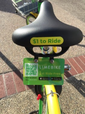 Dockless bicycles can be unlocked by scanning a QR code located on the bike (as seen in the first two photos), or using a code sent to the user to open either a manual or automatic lock (as seen in the last two photos).