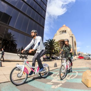 Mexico City was a pioneer in large scale bike share systems with their launch of ECOBICI in 2010. Today, it has become Latin America's largest station-based bikeshare system. ECOBICI remains a high-performance system with 5.4 daily trips per bike, and 19 bikes per 1,000 residents. The system now offers traditional and pedal assist e-bikes, making it one of the few hybrid systems in the world. Four dockless operators are also offering bikeshare as part of a pilot program, and are required by the city to provide real time tracking, verifiable user information, and bike parking areas. ECOBICI's ridership numbers have remained strong.