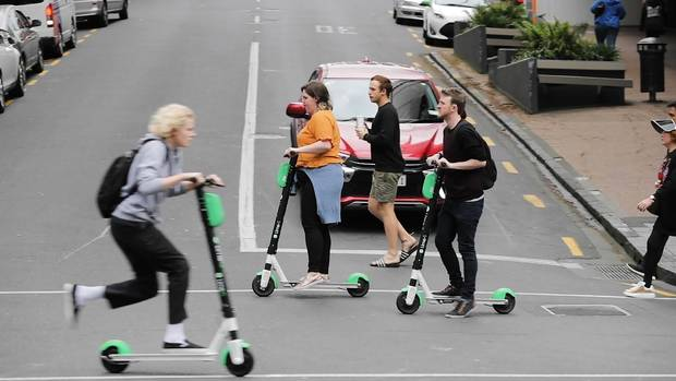 Lime scooter riders in New Zealand. Photo cred: NZ Herald