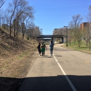 three women walking on the greenway, Minneapolis. Sunny day