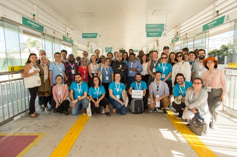 MOBILIZE participants take a group picture in a bus terminal. Bike parking and bike share options have been integrated with bus stations and terminals.