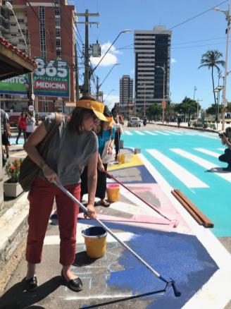 MOBILIZE participants had the opportunity to participate in a tactical urbanism project where they reclaimed space for pedestrians through paint, planters, and urban furniture.
