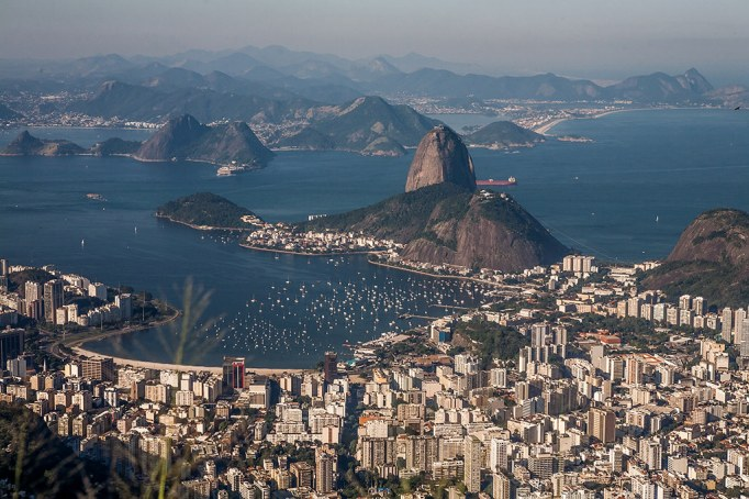 Sugarloaf Mountain overlooks Guanabara Bay, part of Rio de Janeiro's iconic and recognizable skyline.