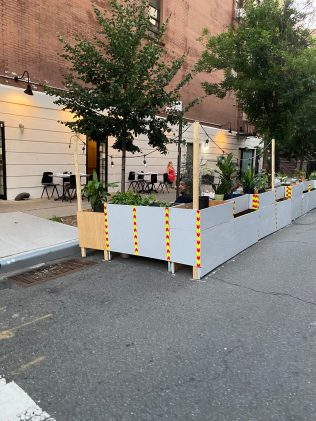 In Harlem, a restaurant created an outdoor dining space on a side street.