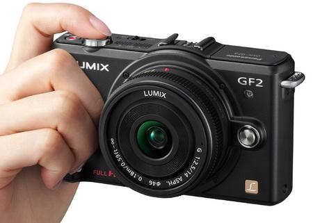 Panasonic LUMIX DMC-GF2 DSLMicro Mirrorless Camera on hand