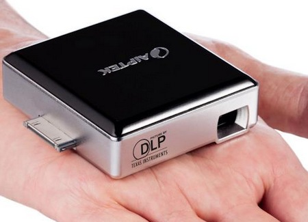Aiptek MobileCinema i50D pico projector dongle for ios devices on hand