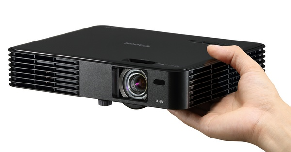 Canon LE-5W Ultra Portable Multimedia Projector on hand