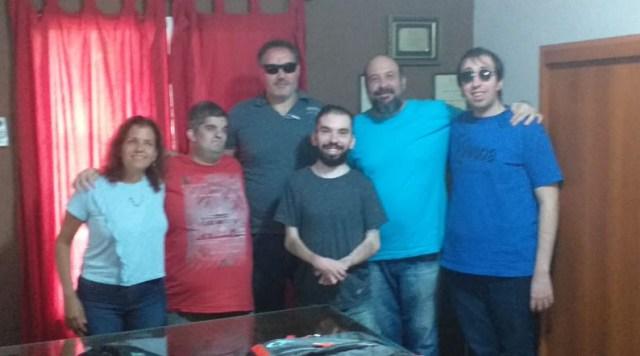 Foto grupal con miembros.