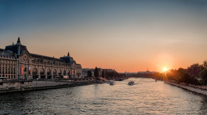 The Musee Dorsay on the Seine river at sunset