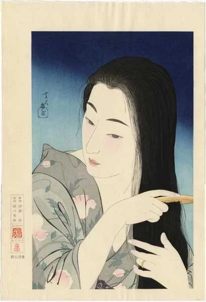 Japanese art - ukiyo-e print of a woman combing her hair