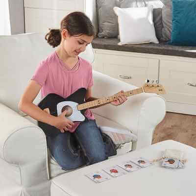 The Simplified Chord Training Guitar - Now you can learn basic chords and play songs almost immediately