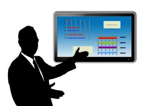 graphic image of a man presenting statistics on a board
