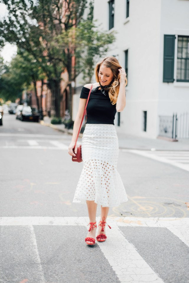 New York Fashion week street style: black off the shoulder top + white skirt + fringe heels