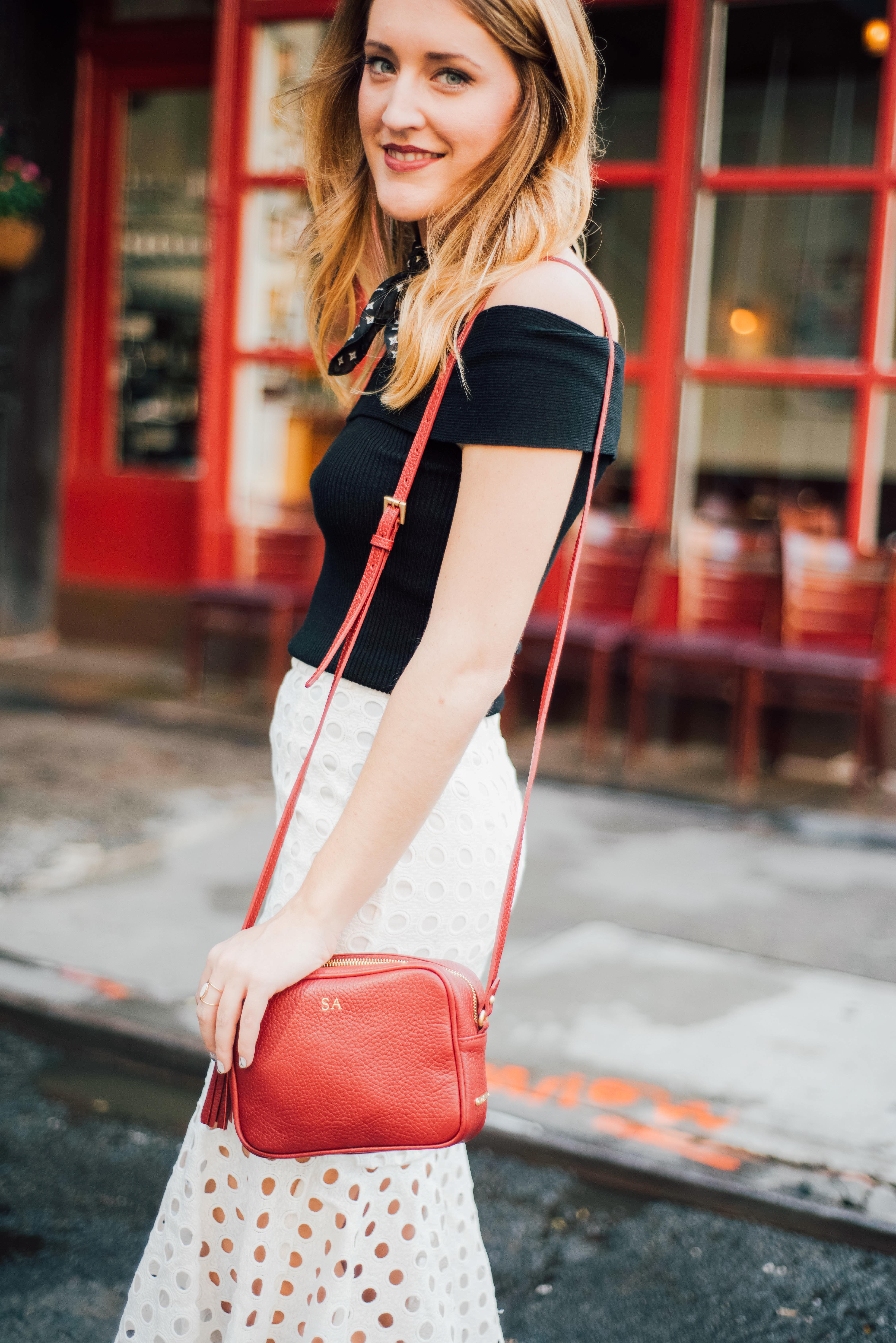 New York Fashion week street style: black off the shoulder top + white skirt + fringe heels
