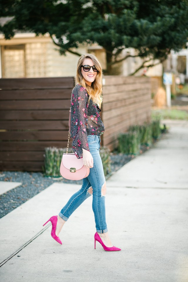 Valentine's Day attire: lace up blouse with a bralatte + distressed denim + pink pumps
