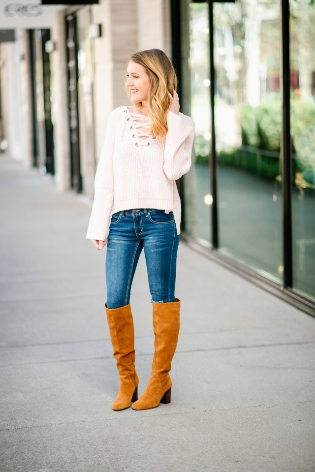 Casual winter style: distressed denim + lace up bell sleeve sweater + cognac suede boots