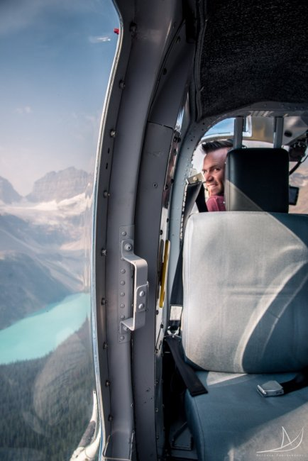 Helicopter flight over a glacier lake