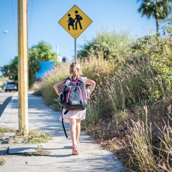 Arias walking to school