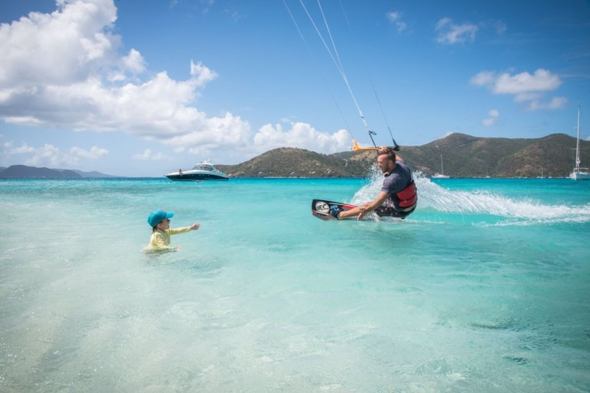 Kiteboarding Sandy Spit, BVI. Coming in for a high-five from Ellia who was playing in the water.