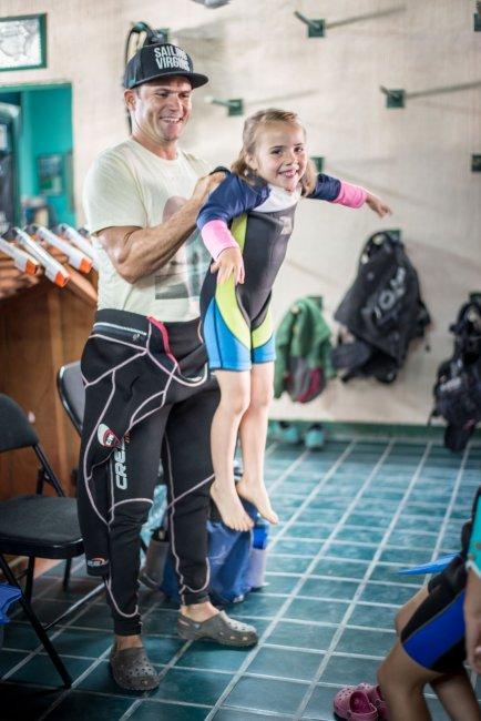 Eben getting Ellia into a wetsuit