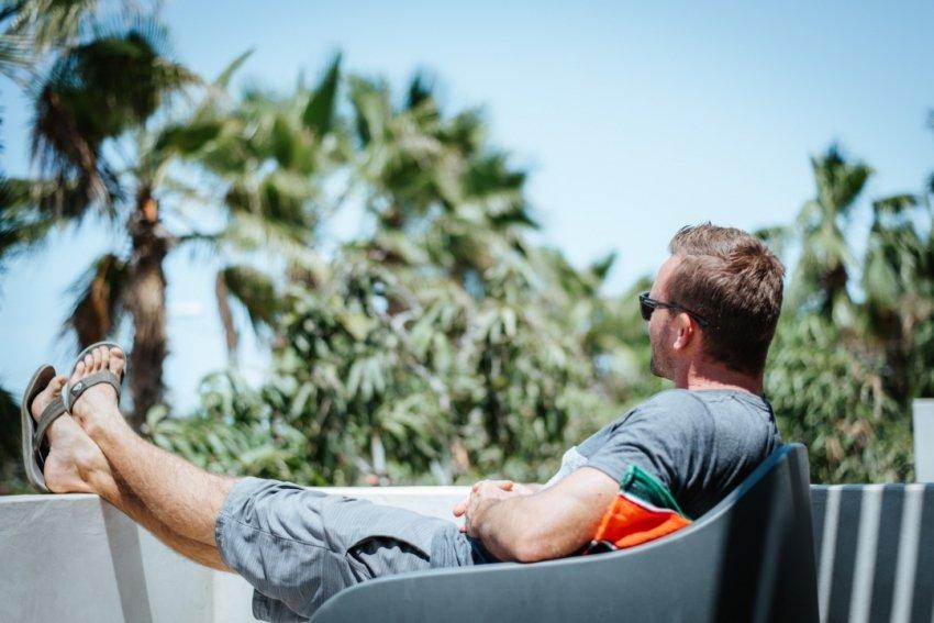 Eben sitting watching the palms