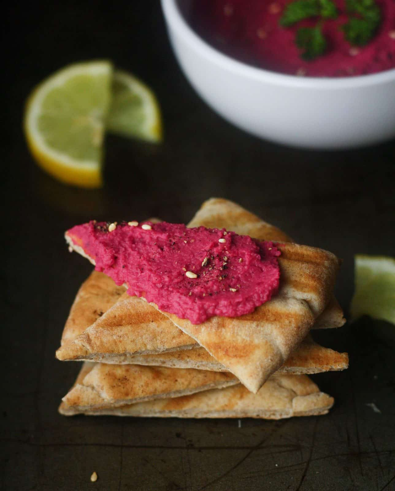 Creamy, Lemon Beet Hummus. Perfect with a side of toasted pita. Super easy recipe! itscheatdayeveryday.com