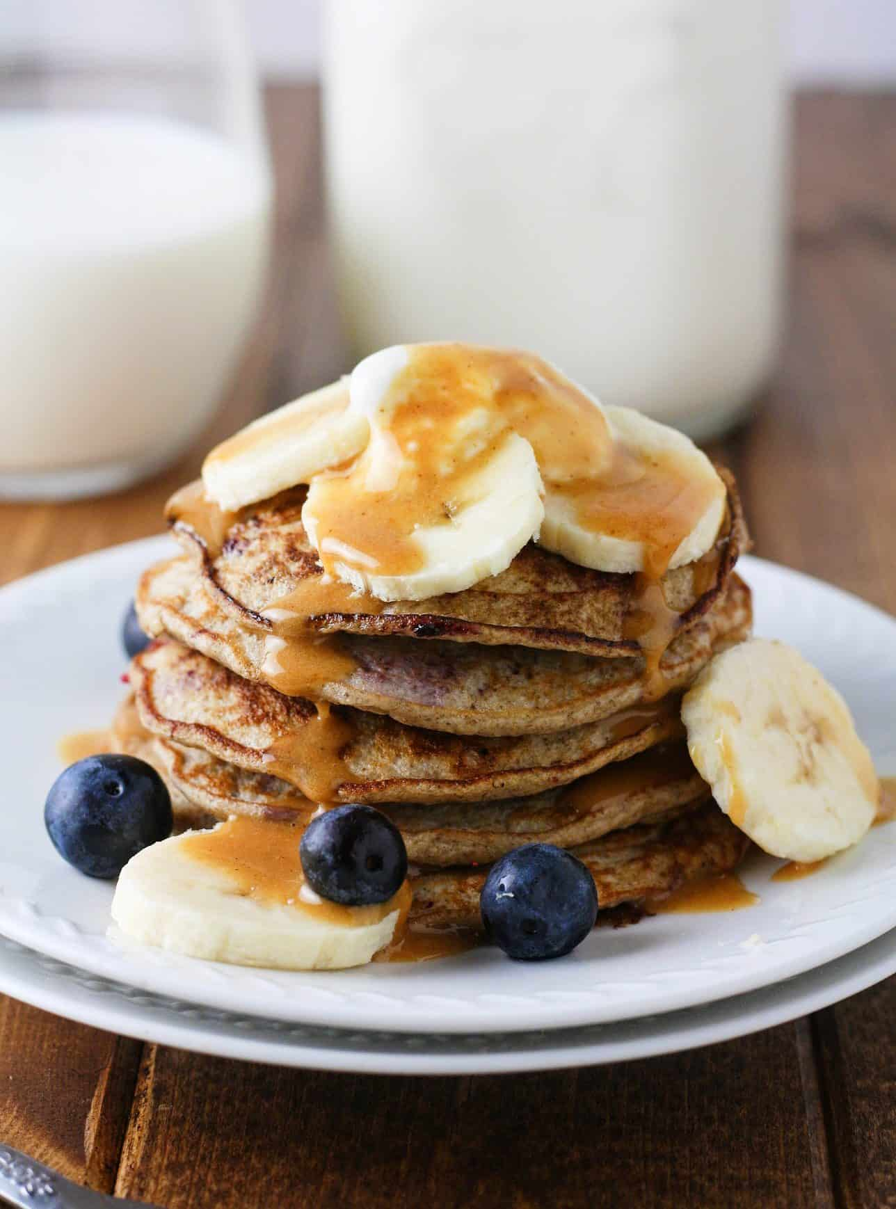 Super easy, healthy and low calorie pancakes made with banana and fresh blueberries. Perfect kick start to a clean morning!   itscheatdayeveryday.com