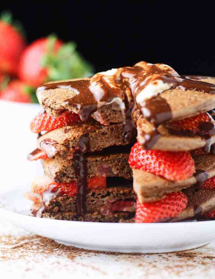 """Nothing says 'I love you"""" like a huge stack of Strawberry Chocolate Protein Pancakes. LOADED with protein, low in calories. www.itscheatdayeveryday.com"""