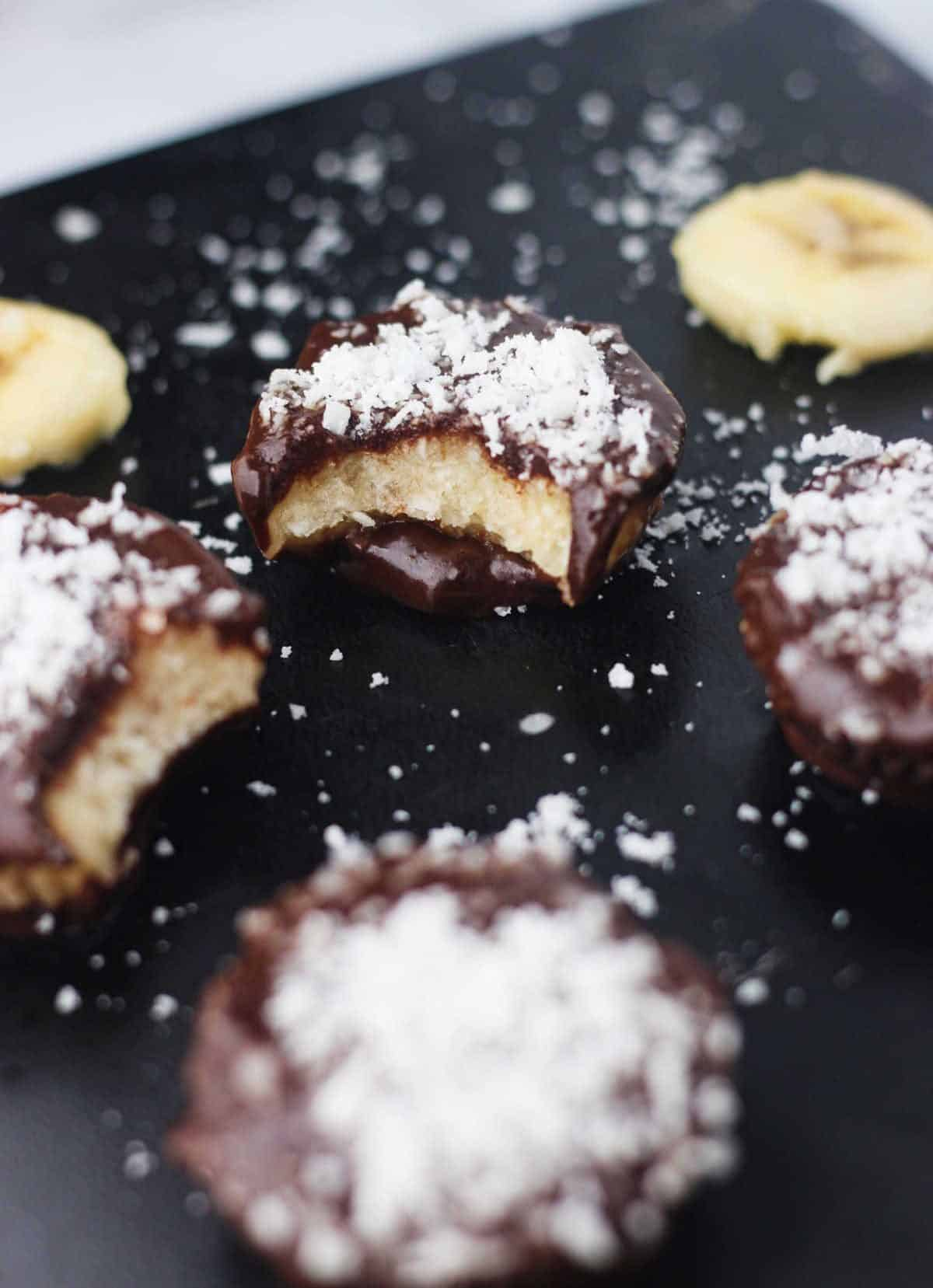 Frozen Banana Bounty Bites ~ Frozen dark chocolate cups filled with a naturally sweet coconut and banana filling. www.itscheatdayeveryday.com