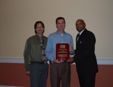 Ken Kenna (L) and Tom Sever receive the Public Sector Member of the Year Award from Derrick Crowder
