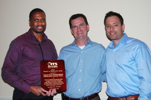 Alvin James, Kimley-Horn (L) and Chester Thomas, GDOT (R) accept the Project of Significance Award from President Tom Sever