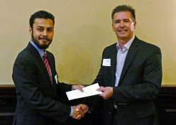 Anirban Chatterjee (L), receives a check for being awarded an ITS Georgia 2016 Wayne Shackelford Scholarship from Keary Lord