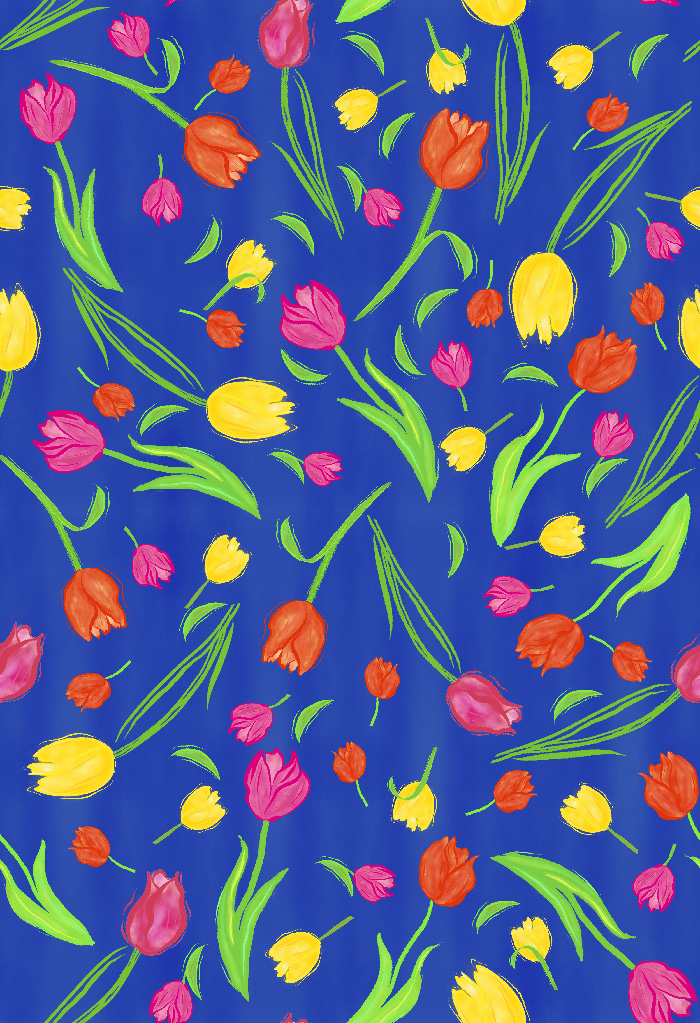 pattern of scattered colored tulips on blue background