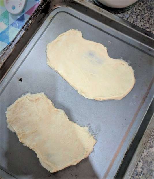 the spicy bean - dough flattened into two shapes that look like insoles