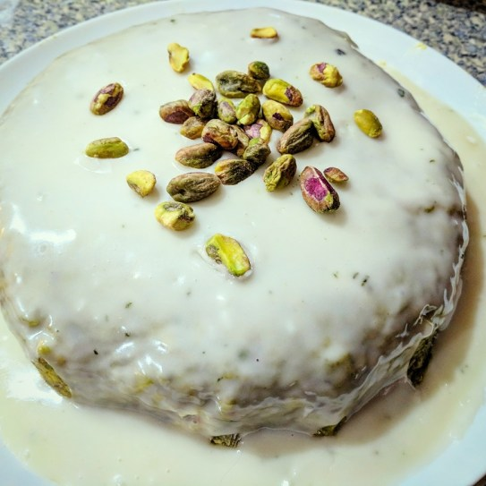 the spicy bean - image of le gateau vert complete, covered in fondant with a vaguely green tinge and topped with shelled pistachios