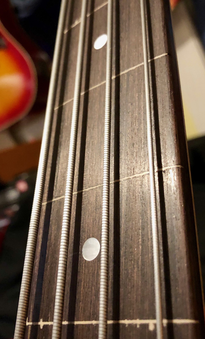 A smooth, fast rosewood fingerboard...with just a bit of chipping during the fret removal.
